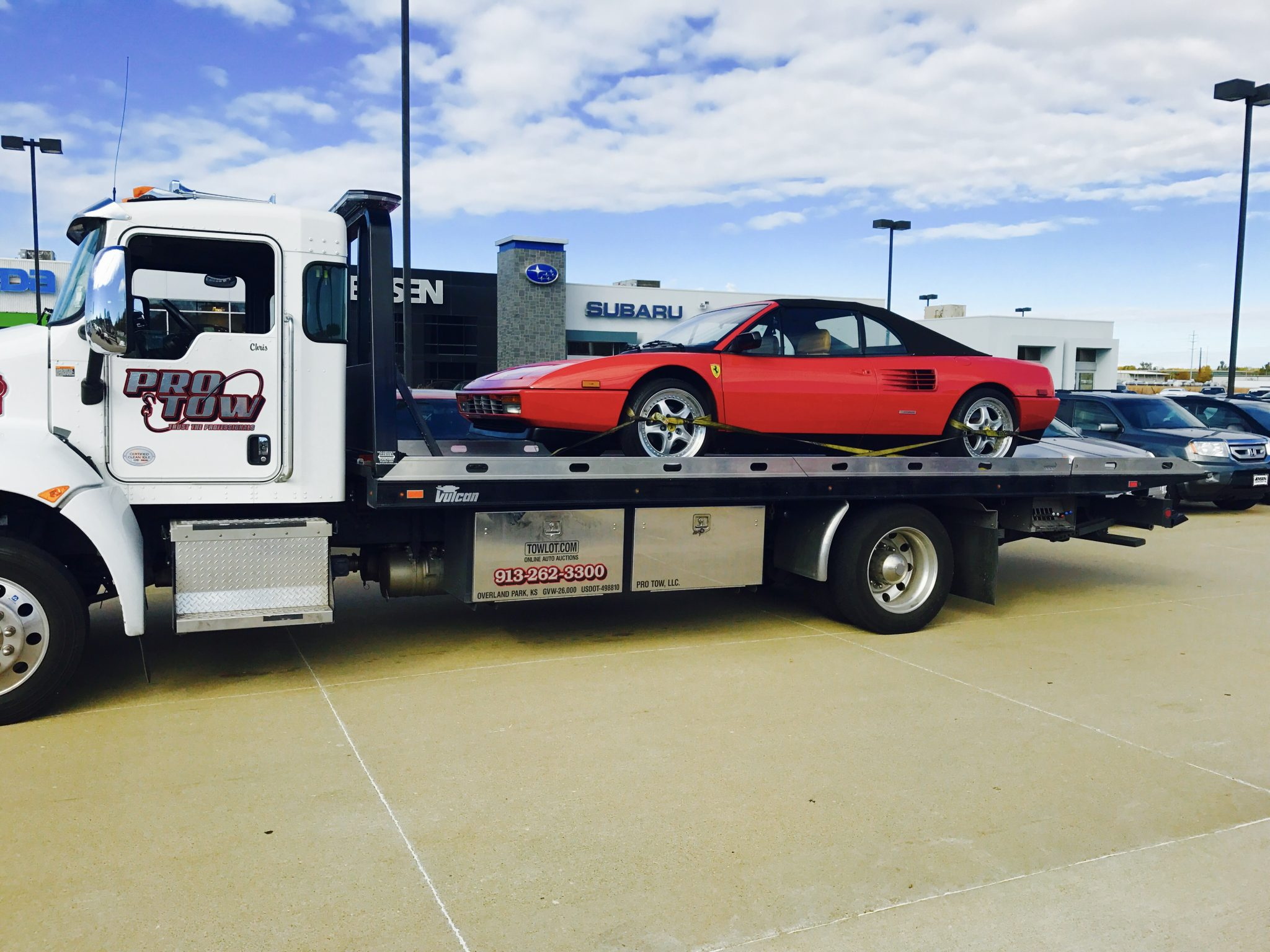 Pro Tow, Llc With Red Ferrari On Flatbed Tow Truck